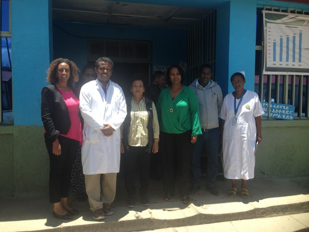 AIHA and Debre Berhan staff pose with Dr. Debrework Zewdie during her tour of the hospital campus.