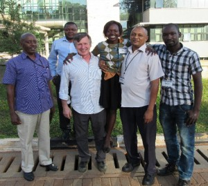 AIHA's Uganda Program Coordinator and the Eagleson trainer  pose with the four Ugandan biomedical engineers who completed the year-long biological safety cabinet calibration and certification training program supported by AIHA.